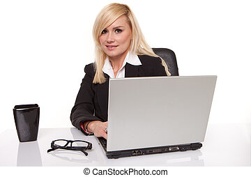 Efficient businesswoman working on her laptop
