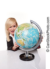 Woman planning her dream holiday - Beautiful young blonde...