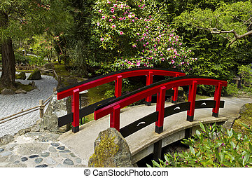Japanese Garden with Red Bridge - Red bridge in Japanese...