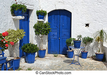 Typical greek courtyard. - Typical greek courtyard with blue...