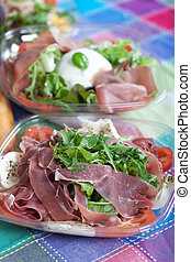 Salads - Delicious variety of italian salad with ham and...