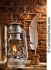 composition of old writing items and kerosene lamp