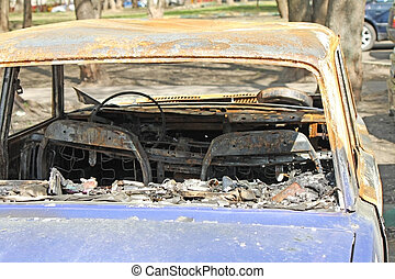 Burned car - A fully burned car in the street