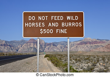 Do Not Feed The Wild Horses Sign