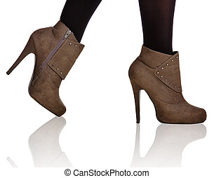 brown high heel boots closeup - close-up of woman legs in...