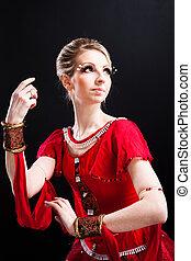 ballerina wearing red tutu posing o