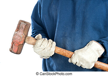 Man holding sledgehammer - A man wearing old leather gloves...