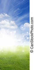 Green field, blue sky, white clouds, bright sun