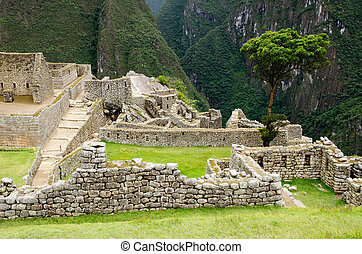 The Inca ruins at Machu Picchu, Peru - The ancient Inca...