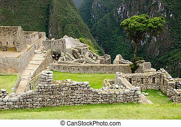 The Inca ruins at Machu Picchu, Peru - The ancient Inca...