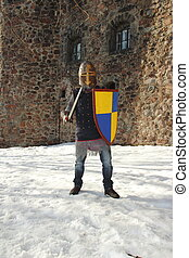 Knight in armor - warlike knight in armor against the...