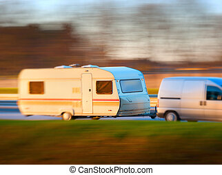 mobile home - Van with long mobile home in blurred motion