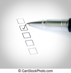 Checklist on white paper and pen