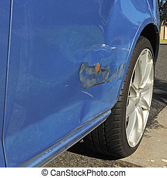 Car body damage - Damage on blue car door with bending,...