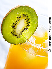 orange juice with slice of kiwi