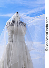 Wedding Gown - White wedding gown shot against blue sky