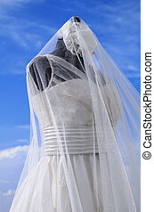 Wedding Gown - White wedding gown shot gainst blue sky
