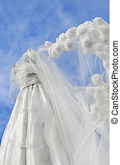 Wedding Gown - White wedding gown with roses shot against...