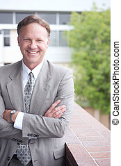 portrait of a confident mature businessman standing outside...