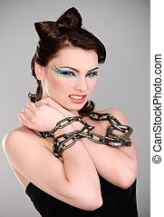 Young brunette with chain and makeup
