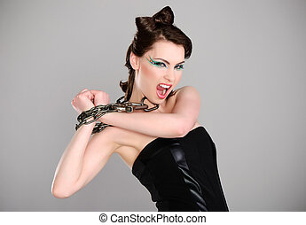 young beautiful woman with chain and makeup