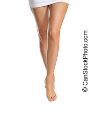 female legs making step isolated on white