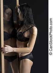 sexy woman next to mirror - sexy and beautiful woman in...