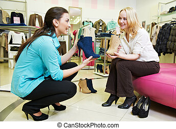 man and assistant at shoe shopping - Young man and woman...