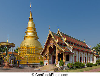 The 46-metre tall golden Chedi which is a major place of worship, Phra That Hariphunchai Woramahawihan Temple, Lamphun, Thailand
