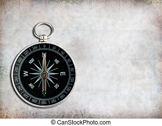 Compass - Classic compass on grunge paper  background.