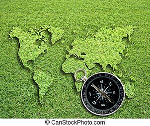 Compass - Classic compass on grass field world map...