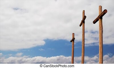 Three Wooden Crosses and Clouds Loop - Three rugged wooden...