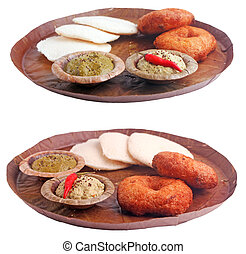 South indian breakfast idli, vada,chutney on white -...