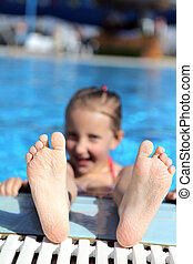 Girl swimming in the pool for a long time