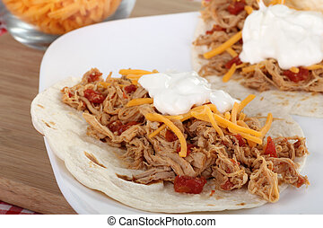 Pulled Pork Taco - Pulled pork with cheese and sour cream on...