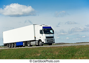 White lorry with white trailer over blue sky