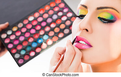 make-up lipstick - Beautiful woman having lipstick applied...