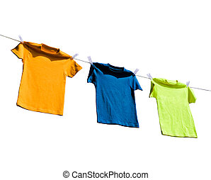 Photograph of four blank t-shirts