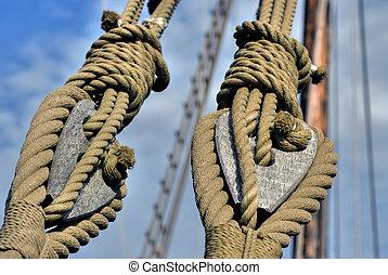 Tackle   - Natural fibre ropes and wooden tackle blocks
