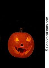 Halloween pumpkin - Pumpkin lit up from inside against a...