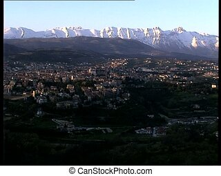 LAQUILA cityscape with mountains - The italian city of...