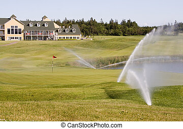 Sprinklers on a Golf Course watering the green