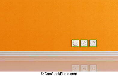 Wall outlets on the orange wall - Wall outlets on the orange...