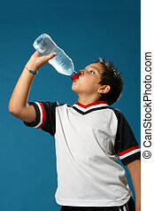 Thirsty boy drinking water - Thirsty boy drinking fresh...