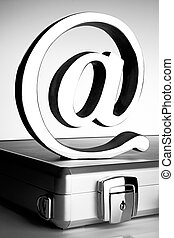 At symbol on briefcase - At symbol paperweight on a...