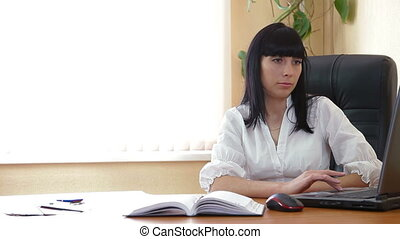Businesswoman Signing Document In The Office