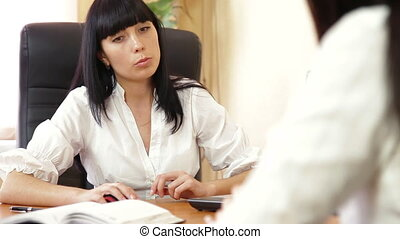Working With Customer In Office - Business woman working...