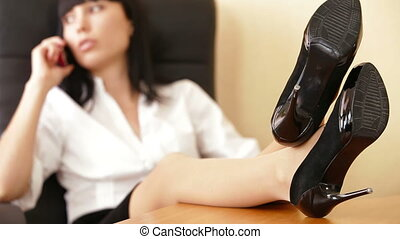 Businesswoman With Feet On Table