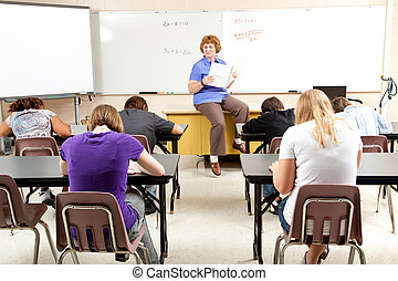 Stock Photo of Math Class - Teacher at the head of the...
