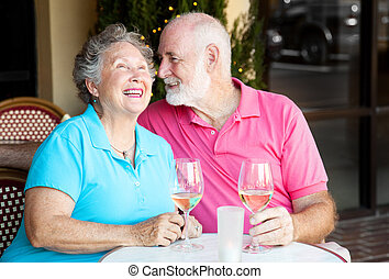 Senior Couple - Wine and Conversation - Senior couple at a...
